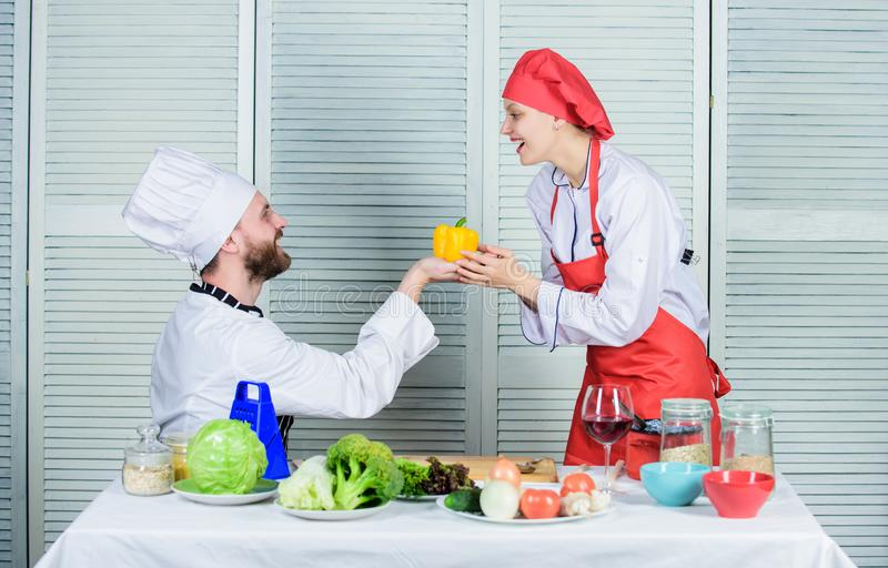 Vegetarian. cook uniform. Dieting vitamin. culinary cuisine. happy couple in love with healthy food. Family cooking in royalty free stock image