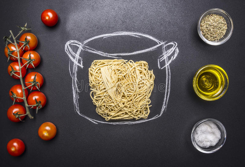 Vegetarian cooking pasta, painted pot, cherry tomatoes, Oil and seasonings wooden rustic background top view stock images
