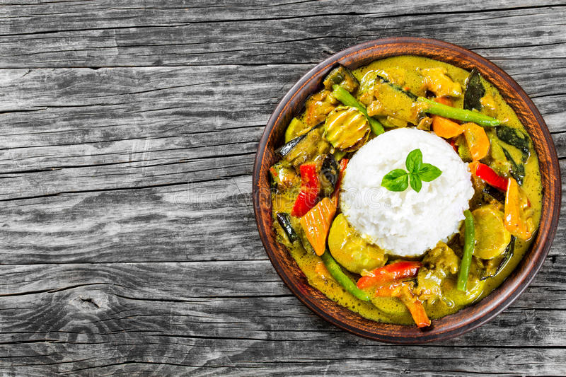 Vegetarian curry with rice, coconut, ginger, soy sauce top view.  stock photo