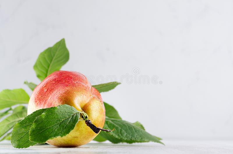 Vegetarian dieting food - ripe fresh pear lay in white modern kitchen interior. stock photo