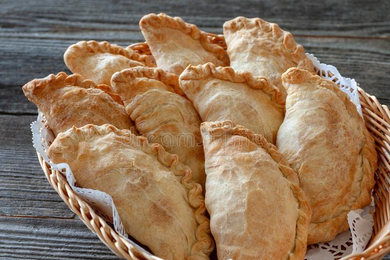Vegetarian dish: potato pies in a basket, close-up royalty free stock photography