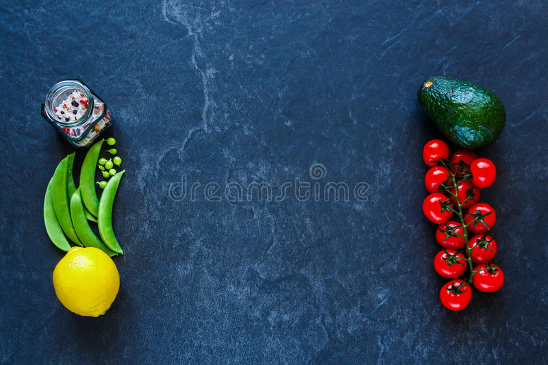Vegetarian eating concept. Clean, vegan, vegetarian eating concept over dark concrete background,copy space. Frame, Flat lay, overhead. Food background royalty free stock photo