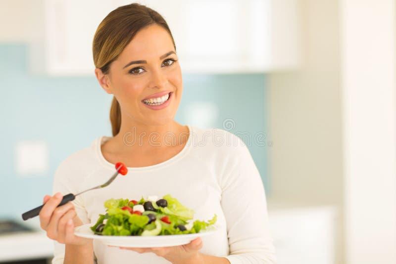 vegetarian eating salad stock photography