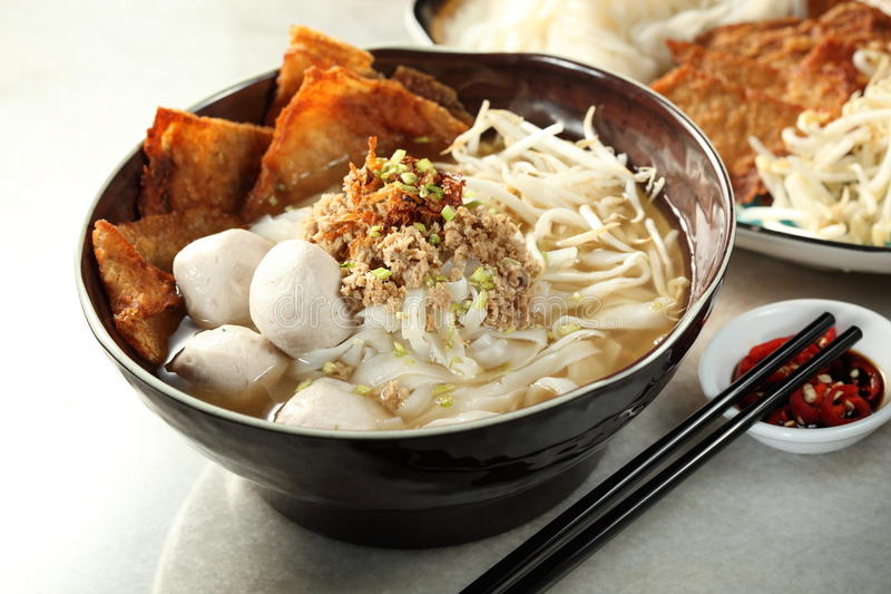 Vegetarian food. Chinese vegetarian fish ball soup with noodle stock images