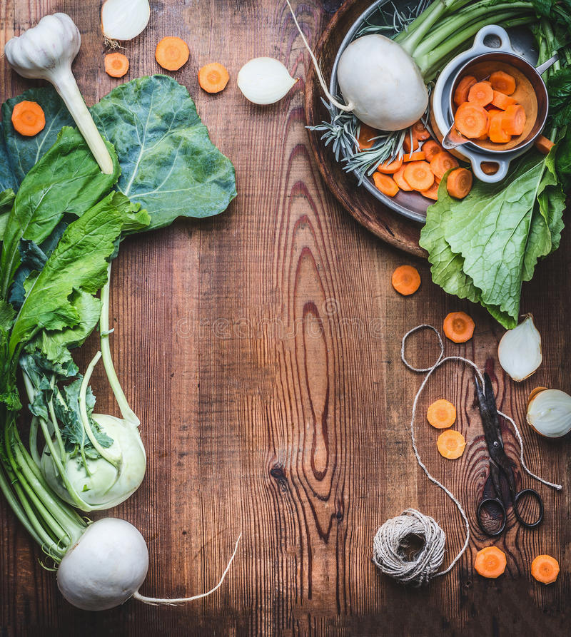 Vegetarian food background with fresh organic local vegetables on wooden rustic kitchen table, top view, cooking preparation. Hea stock photo