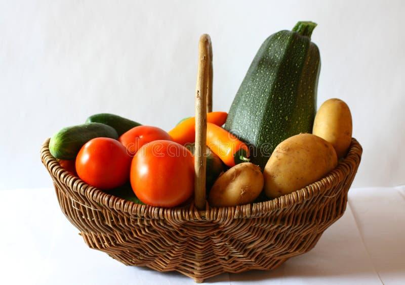 Vegetarian Food basket. Potato, sweet pepper, tomato, cucumbers and Zucchini in the Vegetarian food basket stock image