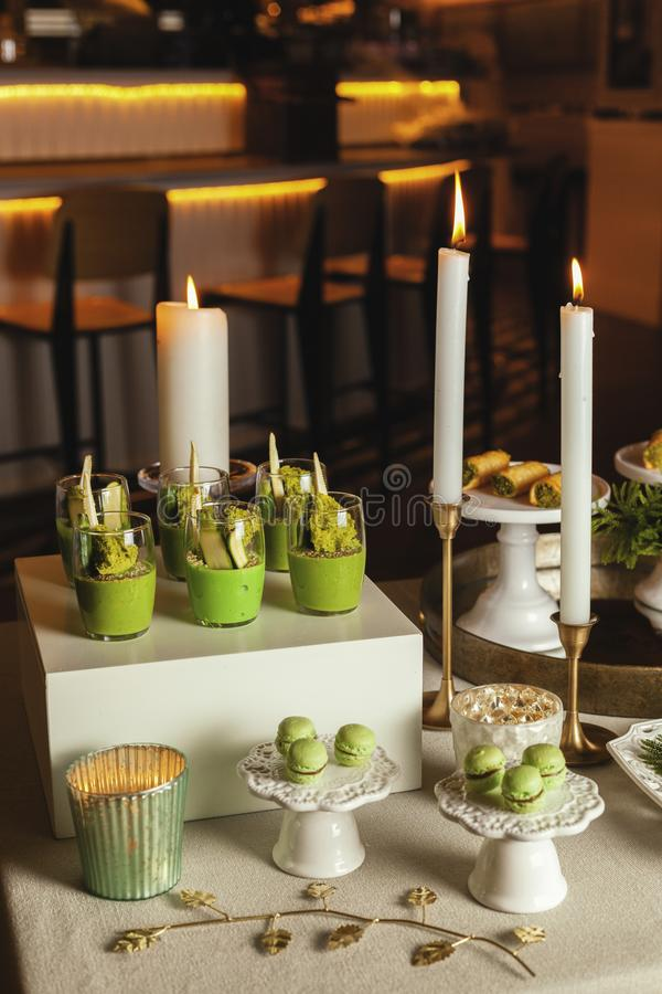 Vegetarian food. Cups with Hummus decorated with flowers, muffins on table. Table set. Close up stock photo