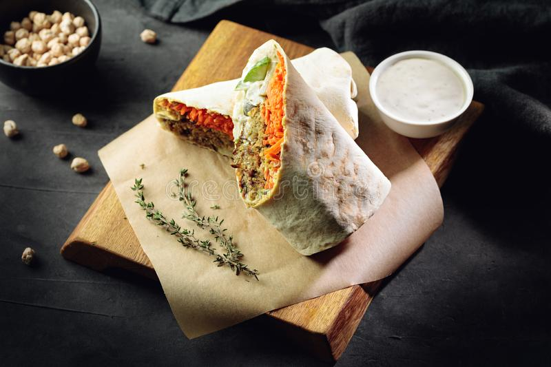 Burrito with falafel and vegetables royalty free stock photos