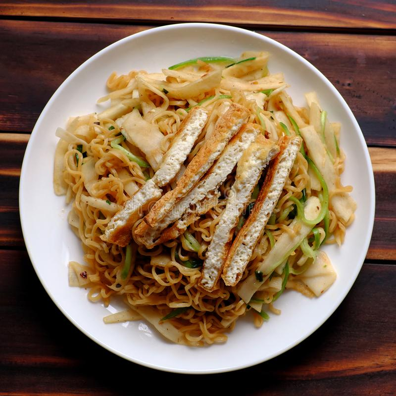 Vegetarian food, fried noodles with sour bamboo shoots and tofu royalty free stock photos
