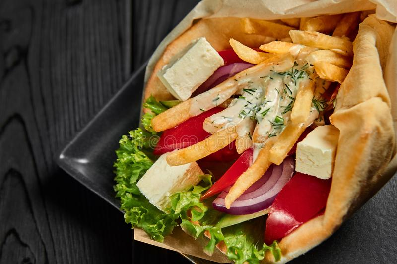 Vegetarian gyro in pita with vegetables and tzatziki. Greek cuisine dish. healthy fast food. Close up stock images