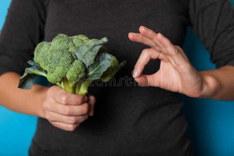 Vegetarian lifestyle concept, hands holding vegetable for diet stock photo
