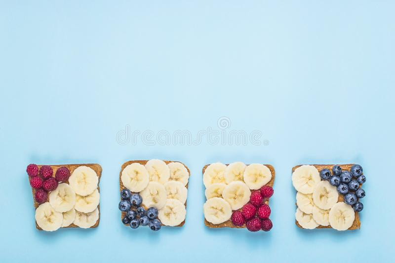 Vegetarian Lunch Sandwich with Peanut Butter, Banana, Raspberry and Blueberry stock photo