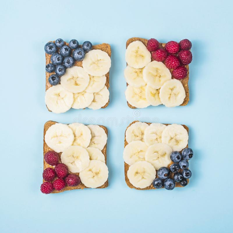 Vegetarian Lunch Sandwich with Peanut Butter, Banana, Raspberry and Blueberry royalty free stock photography