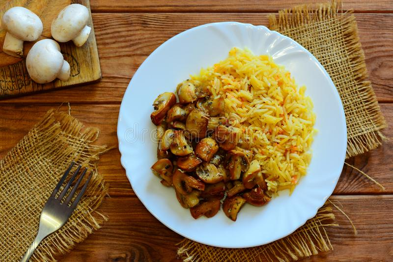 Rice with fried mushrooms easy rice basmati with fried mushrooms on download rice with fried mushrooms easy rice basmati with fried mushrooms on a white plate ccuart Gallery