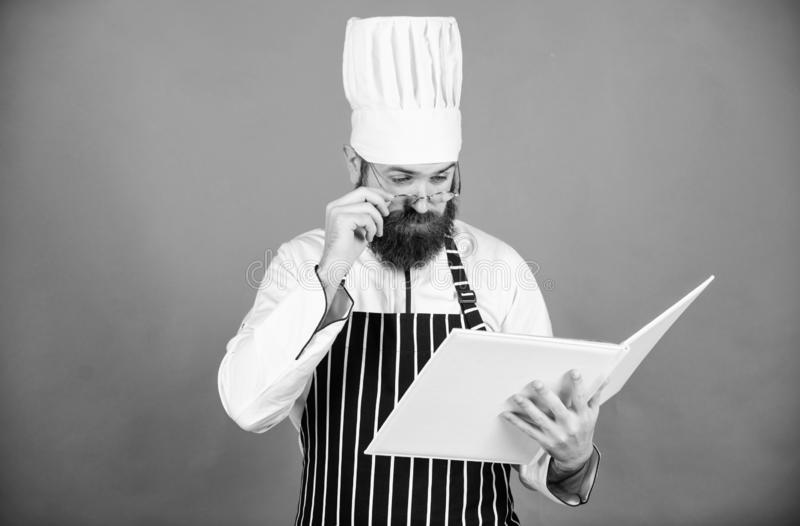 Vegetarian. Mature chef with beard. Healthy food cooking. Chef man in hat. Secret taste recipe. Dieting and organic food. Vitamin. Bearded man cook in kitchen stock images