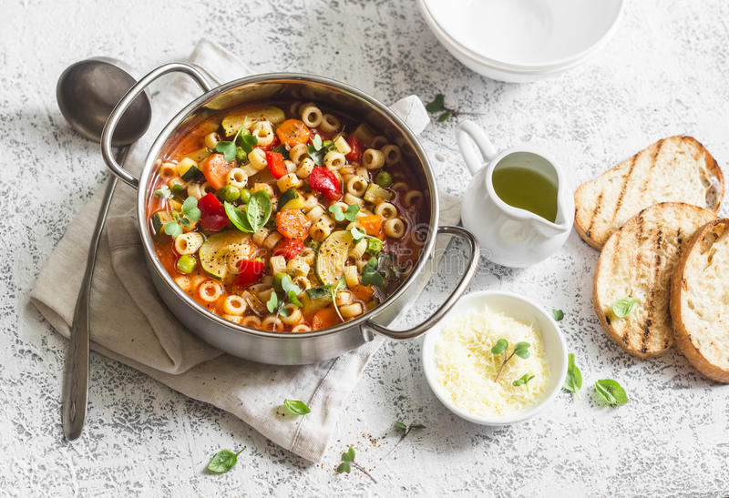 Vegetarian minestrone - delicious healthy mediterranean lunch. On a light table stock image