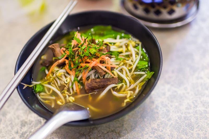 Vegetarian mushroom noodle soup stock photo