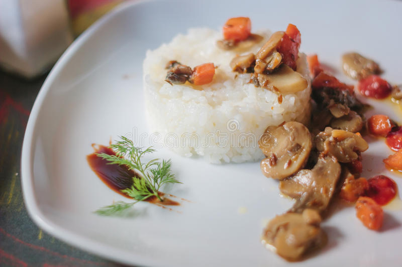 Vegetarian mushroom ragout with vegetables and rice stock images
