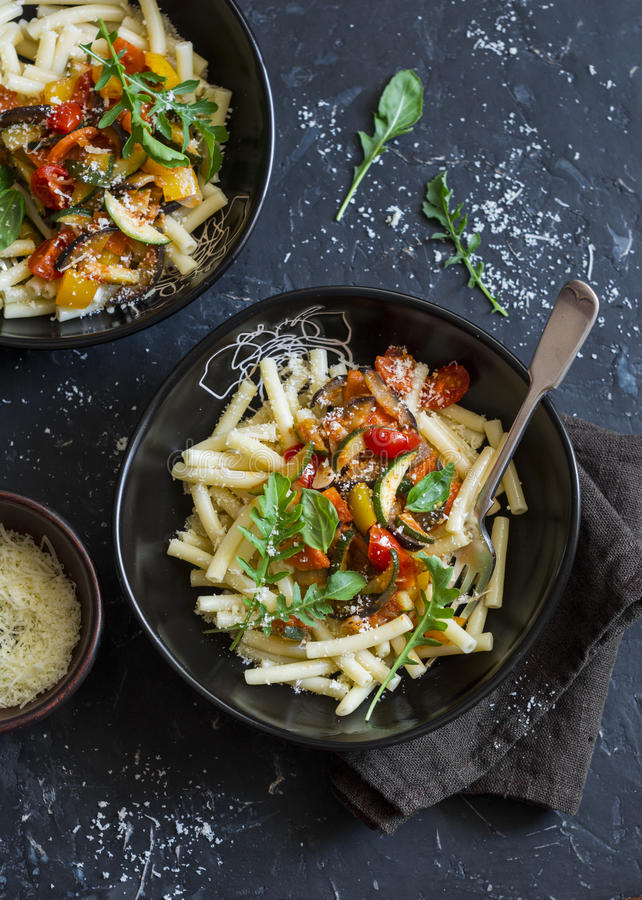 Vegetarian pasta with quick ratatouille. Delicious vegetarian healthy food concept. On a dark background royalty free stock photography
