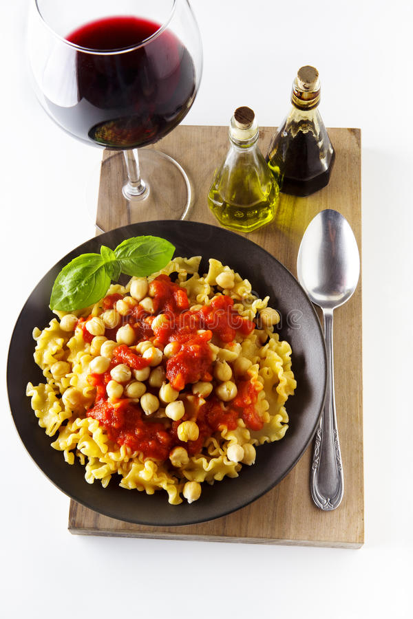 Vegetarian Pasta with Tomato sauce and Chickpeas. and red Wine. stock photography