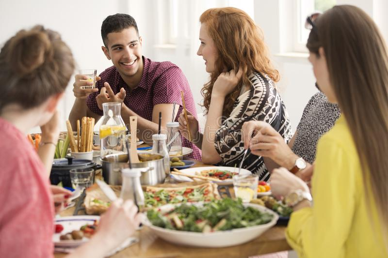 Vegetarian people in restaurant stock image