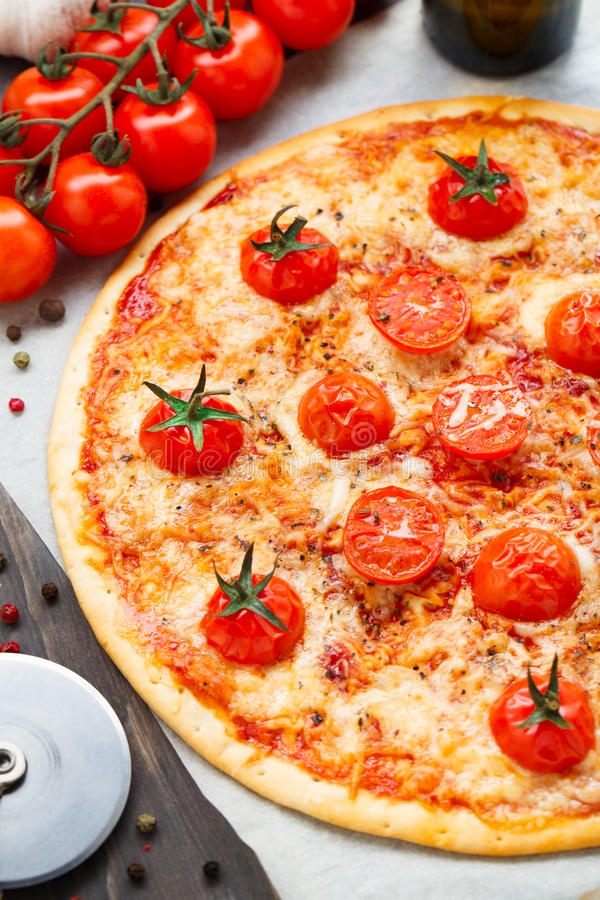 Vegetarian pizza with cherry tomatoes