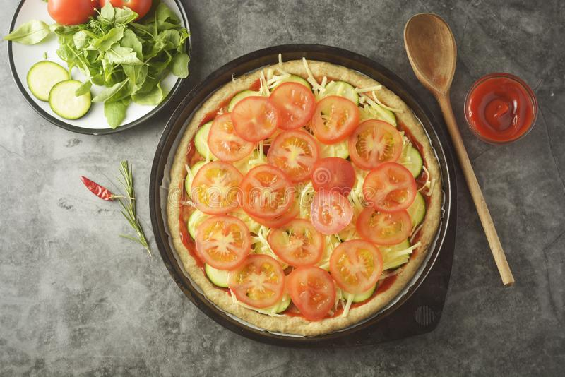 Vegetarian pizza. Cooking process of vegetable homemade pizza with fresh ingredients isolated on dark background. Copy space. Step. By step, flat, lay, top stock photo