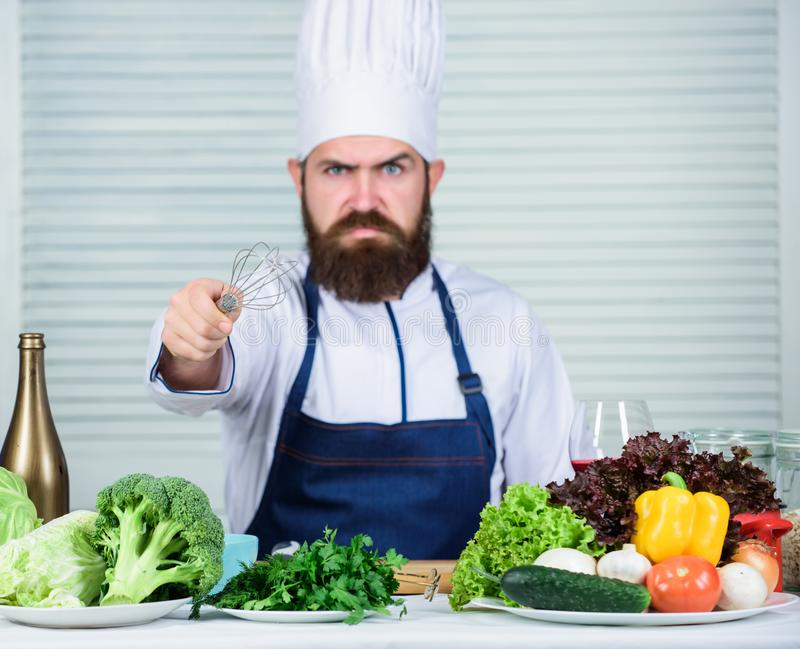 Vegetarian salad with fresh vegetables. Cuisine culinary. Vitamin. Dieting organic food. angry bearded man. chef recipe. Healthy food cooking. Mature hipster royalty free stock image