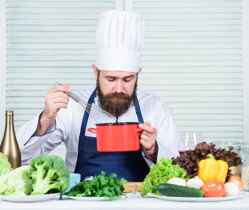Vegetarian salad with fresh vegetables. Healthy food cooking. Mature hipster with beard. Cuisine culinary. Vitamin. Dieting organic food. Happy bearded man stock photos