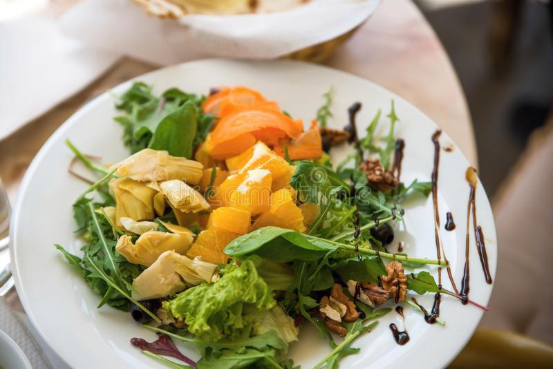 Vegetarian salad with fruit,lettuce, vegetable and walnut. royalty free stock image