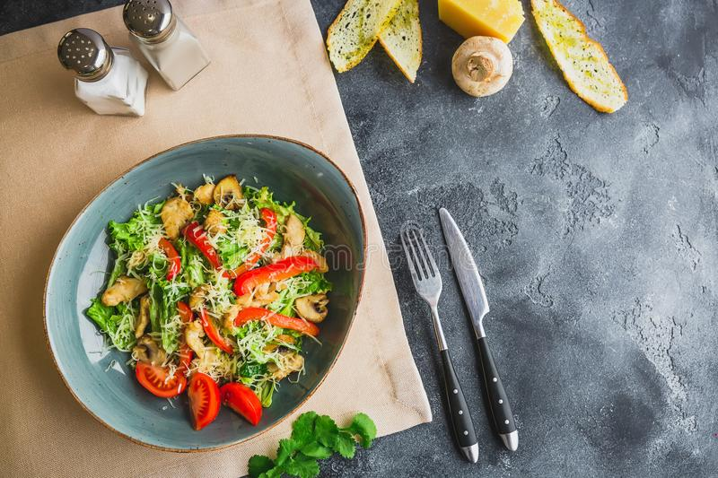 Vegetarian salad with mushroom, cheese, lettuce and pepper in a plate. Flat lay. Top view royalty free stock photo