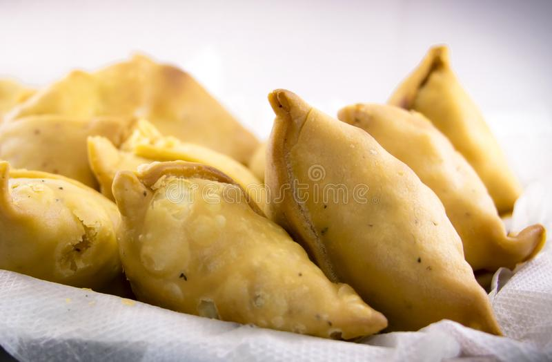 Indian special traditional street food. Vegetarian samosas filled with potato and green pea.Indian special traditional street food royalty free stock image