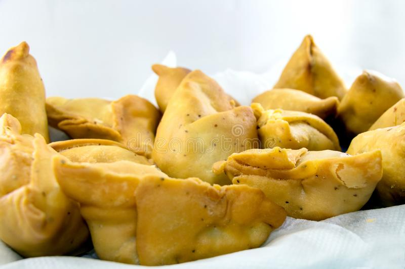 Indian special traditional street food. Vegetarian samosas filled with potato and green pea.Indian special traditional street food royalty free stock photo