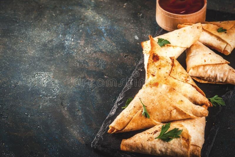 Vegetarian samsa samosas. Asian food. Vegetarian samsa samosas with tomato sauce. Dark blue background copy space stock photography
