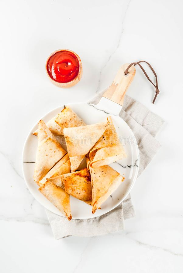 Vegetarian samsa samosas. Asian food. Vegetarian samsa samosas with tomato sauce. white marble background copy space top view royalty free stock images