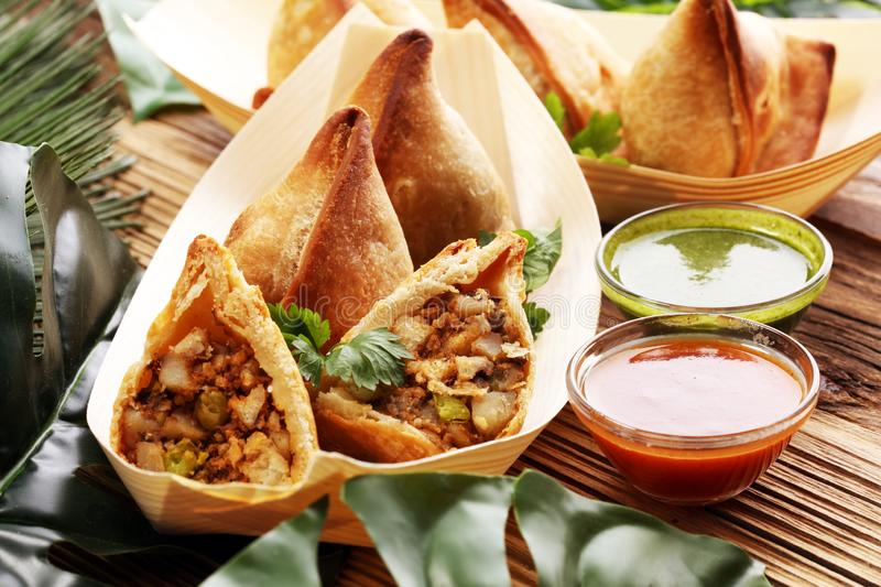 Vegetarian samsa or samosas.Indian special traditional street food punjabi samosa or Coxinha, Croquete and other Fried Brazilian royalty free stock photos
