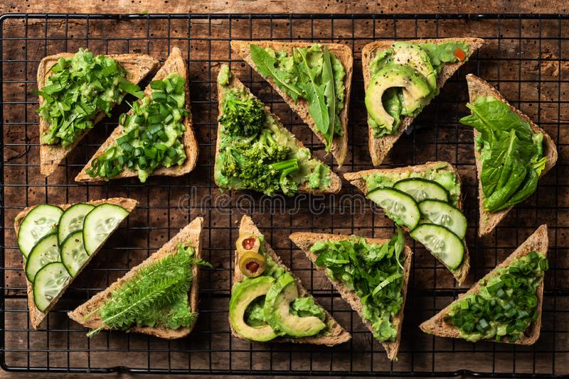 Vegetarian sandwiches with guacamole and vegetables stock photography