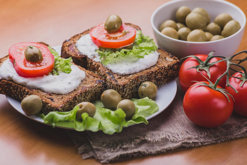 Vegetarian Sandwiches of homemade bread with cheese sauce or cream, lettuce stock photography