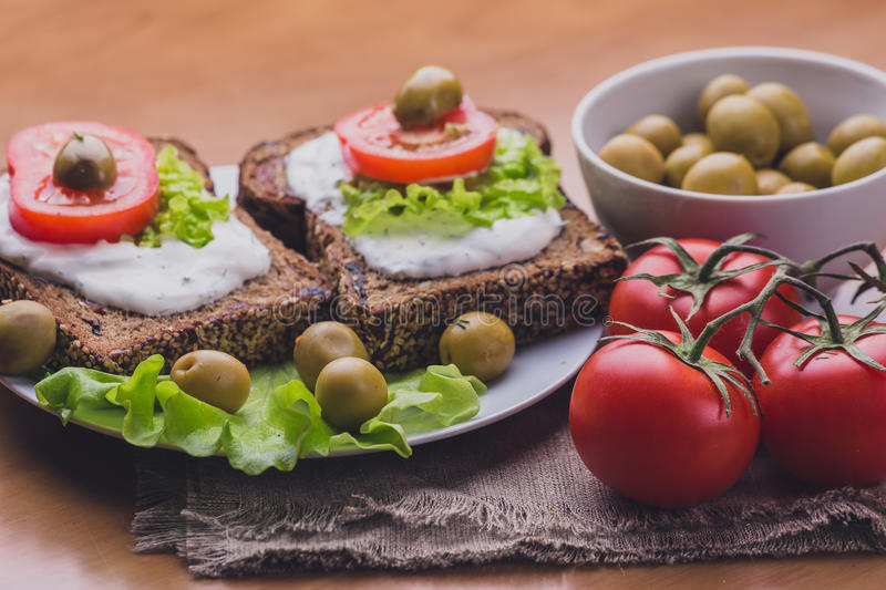 Vegetarian Sandwiches of homemade bread with cheese sauce or cream, lettuce stock photos
