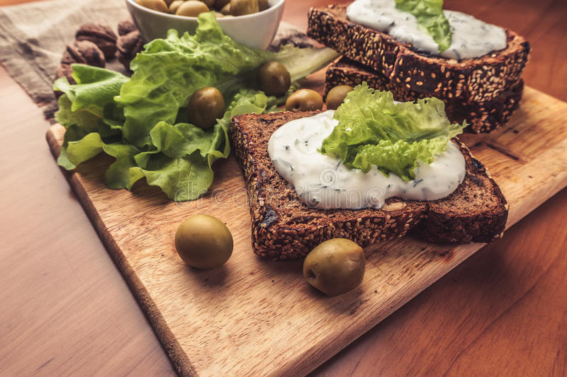 Vegetarian sandwiches with homemade bread, cheese sauce or cream, lettuce stock photography