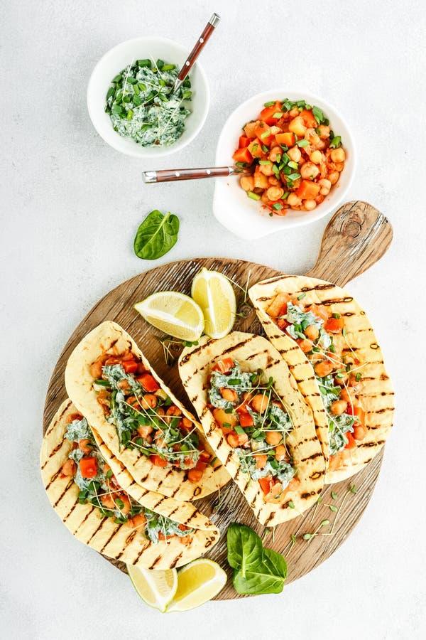 Vegetarian snack of tacos stock photos