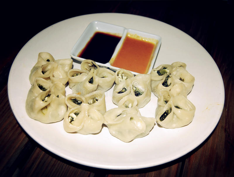 Vegetarian steamed dumplings with spinach - vintage effect. stock photography