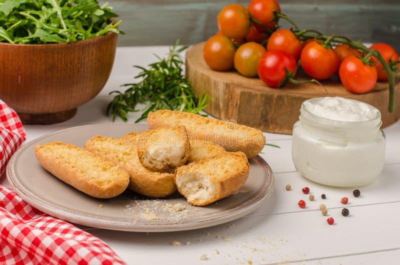 Vegetarian toasts with cream cheese, tomatoes, arugula, rosemary royalty free stock photos