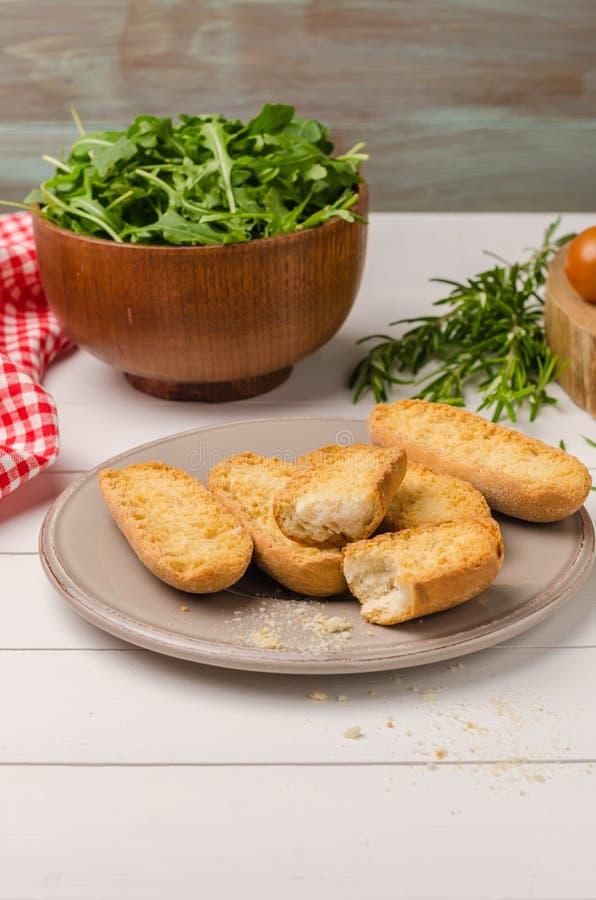 Vegetarian toasts with cream cheese, tomatoes, arugula, rosemary royalty free stock photography