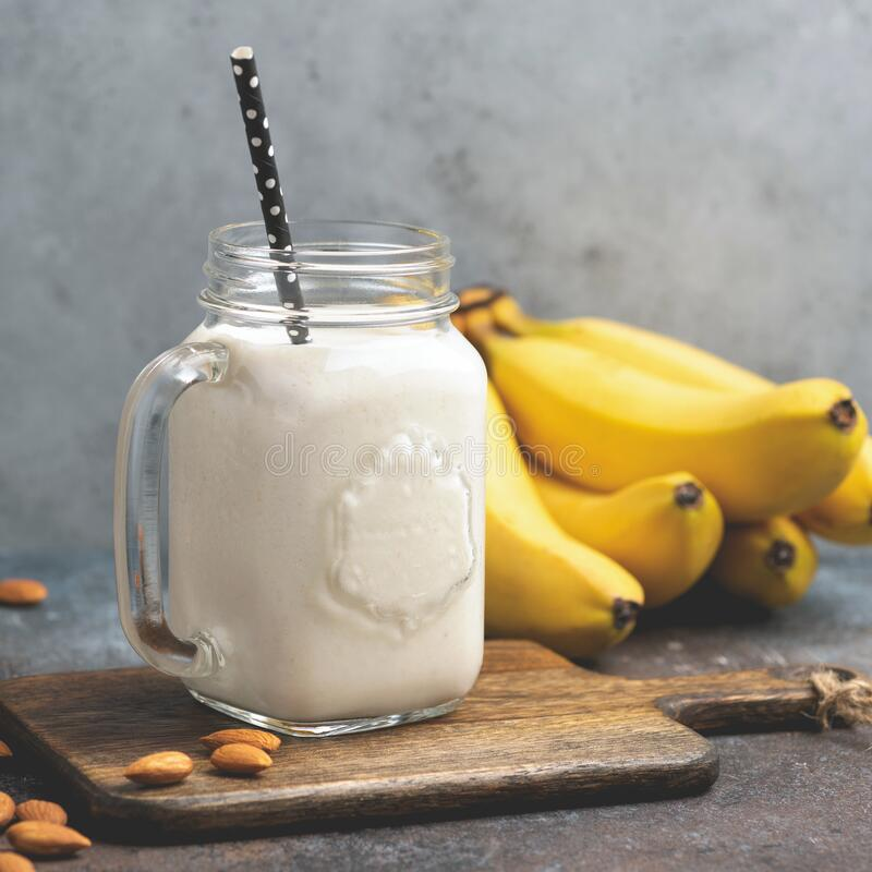 Vegetarian vegan almond banana smoothie stock photos