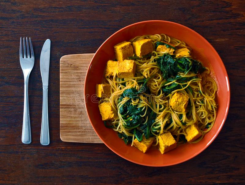 Vegetarian or vegan Indian food with noodles, spinach and tofu royalty free stock photography