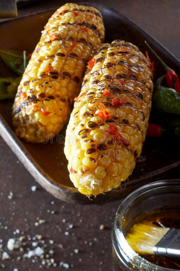 Vegetarian or veggie BBQ meal. Barbecue corn with chili sauce for veggy grill parties royalty free stock photos