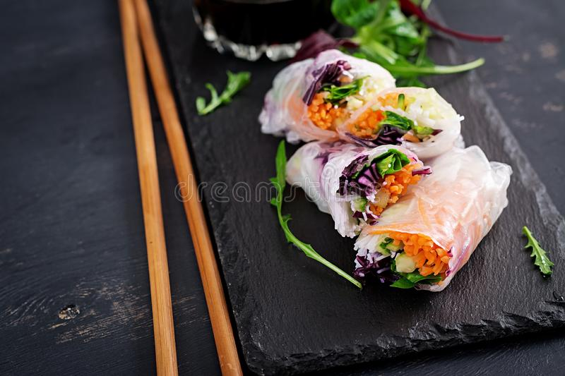 Vegetarian vietnamese spring rolls with spicy sauce, carrot, cucumber, royalty free stock photography