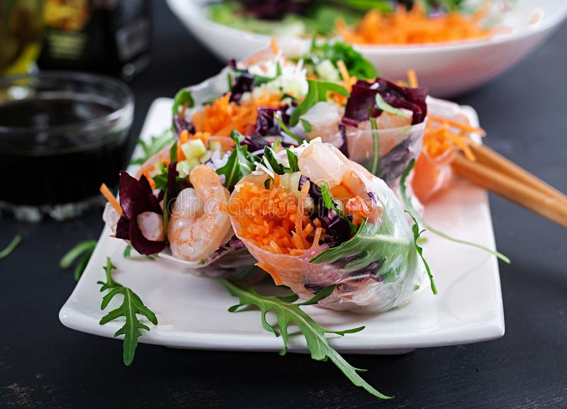 Vegetarian vietnamese spring rolls with spicy shrimps, prawns, carrot royalty free stock photo