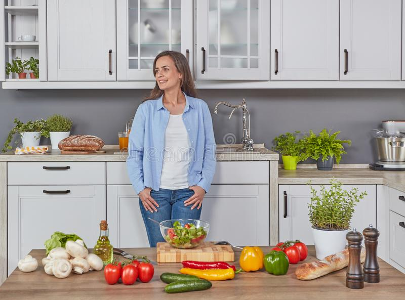 Vegetarian woman in the kitchen stock photo